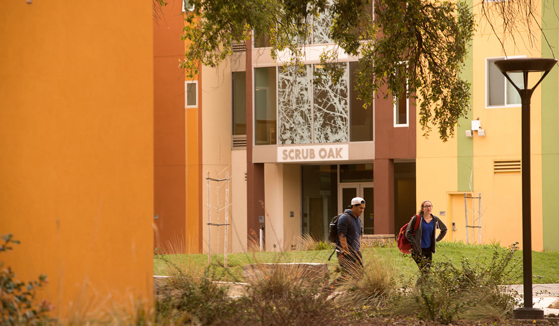 Two Students walking near a UC Davis residence hall