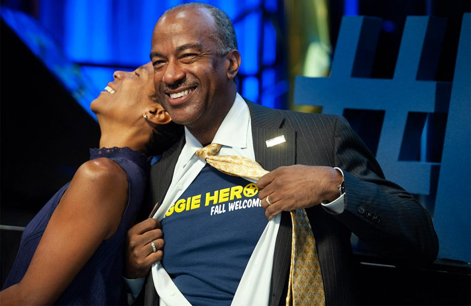 UC Davis' Chancellor Gary May channels his inner Clark Kent to show off Aggie Heroes t-shirt