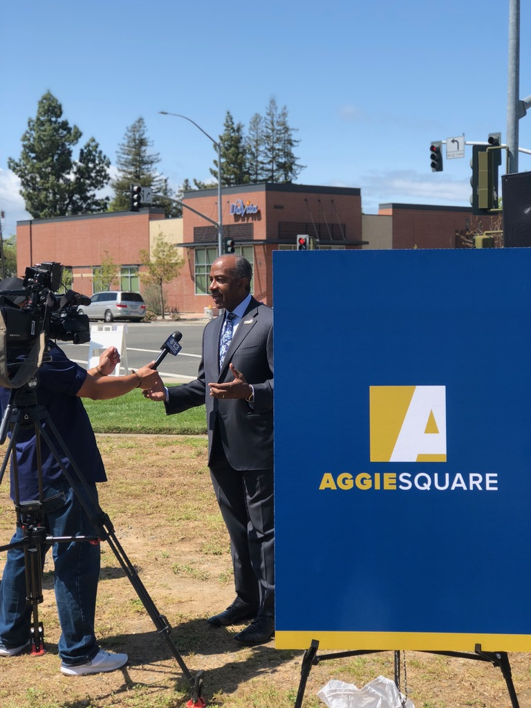 Mayor Steinberg by Aggie Square sign