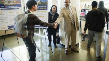 Gary May stops to talk with students while touring the ARC during his first visit to campus on Friday, February 24, 2017.