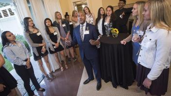 Chancellor Gary May gives a tour of the Chancellor's residence to the men's and women's basketball teams