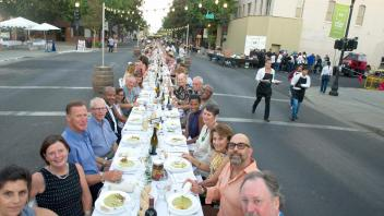 UC Davis table at Woodland's Dinner on Main in the City of Woodland on Sunday, September 17, 2017.