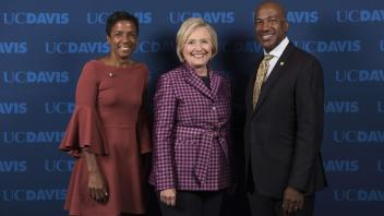 Chancellor Gary May and his wife LeShelle pose for a photo with Hillary Clinton during her October 9, 2017 visit to campus.