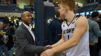 Chancellor May congratulates men's basketball player Siler Schneider.