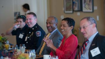 Fire Chief Nathan Trauernicht, Chancellor Gary May, LeShelle May and Provost Ralph Hexter share a laugh during the breakfast held by Chancellor Gary May and LeShelle May on February 2, 2018 at the Chancellor's Residence.