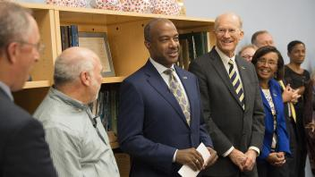 Interim Chancellor Ralph Hexter, professor Dave Rizzo, new Chancellor Gary May and acting provost Ken Burtis stand in front of Rizzo's class as it is announced that Rizzo won the UC Davis Teaching Prize on April 14, 2017.