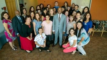 Chancellor Gary May takes a photo with the Latinx Staff and Faculty Association.