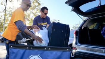 UC Davis Chancellor, Gary May helps students move-in to the Tercero Residence halls on Sunday, September 23, 2018