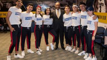 UC Davis Chancellor Gary May poses for a photo with the MK Modern dance group before the start or their performance at the Fall Welcome Event.